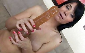 Brunette Beverly riding a brutal anal dildo