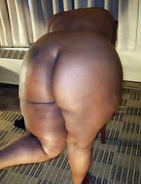 Black column with heavy asses